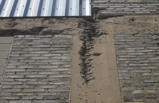 The cement columns with brick in-fill have eroded and allows water directly into the interior.